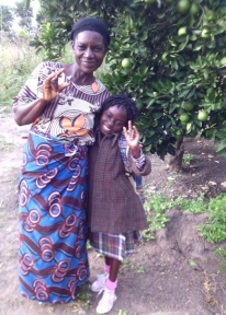 Ketty and her grandmother share a hug as she leaves for the start of the new term